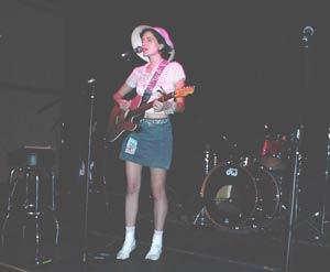 Julien singing Blue Sky Cafe, Nashville in white hat and white boots.
