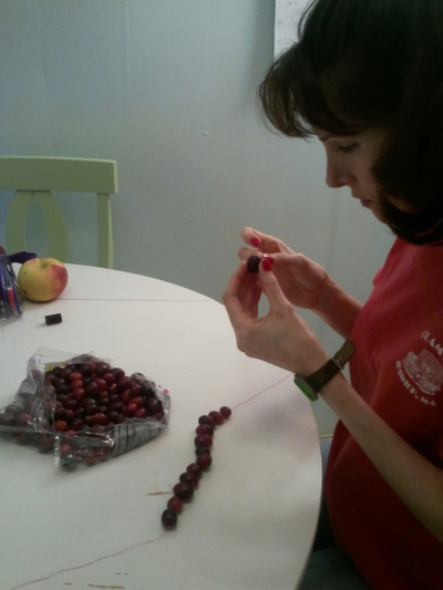 Julien Aklei stringing cranberries to make a cranberry chain.