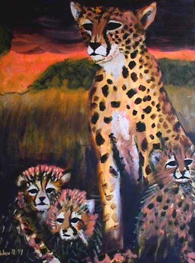 Cheetah mom with baby cheetahs at sunset.