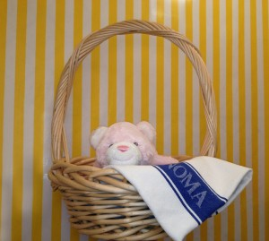 Baby Snuffles in Basket with Tea Towel